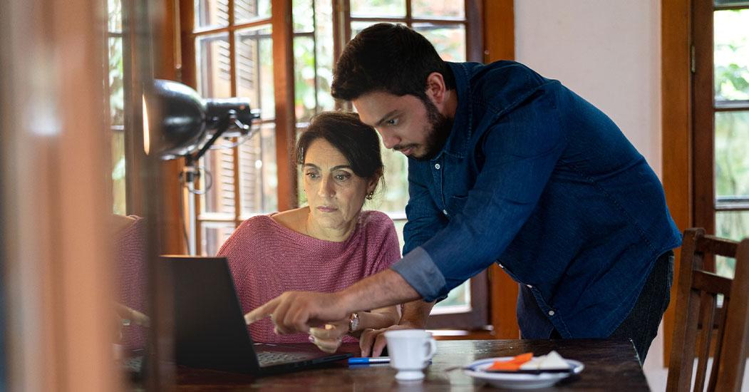 Woman and Man Physician at computer